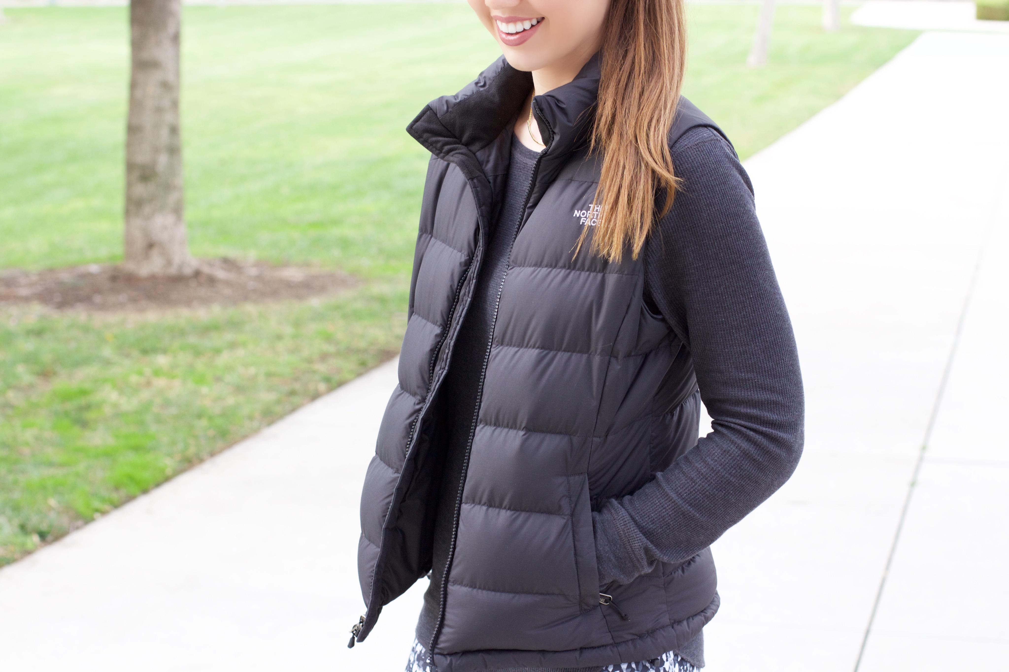 Black North Face puffy vest