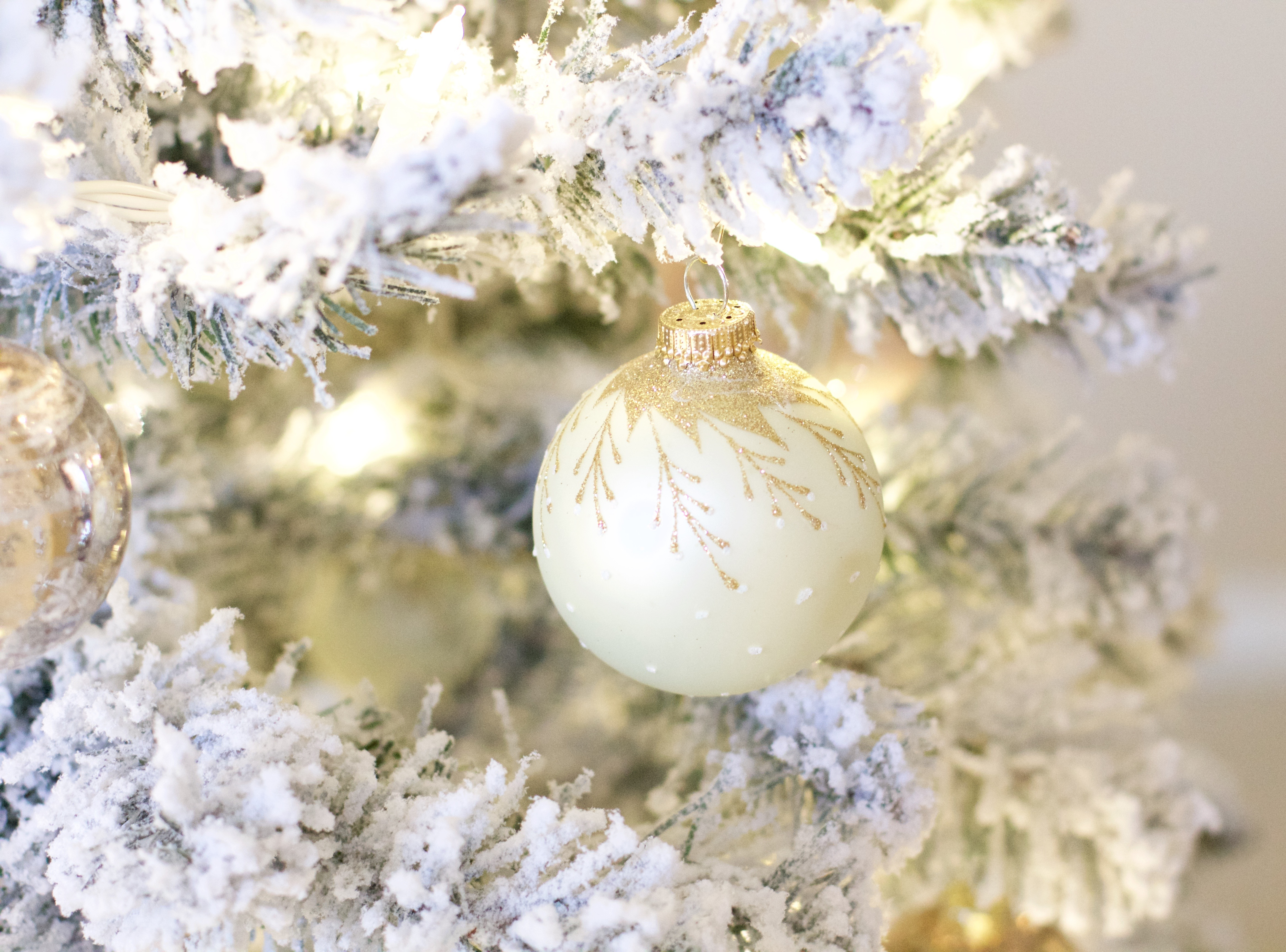 white and gold christmas ornaments
